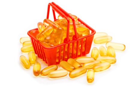 cod oil: Cod liver oil Omega 3 gel capsules in the shopping basket, isolated on white background