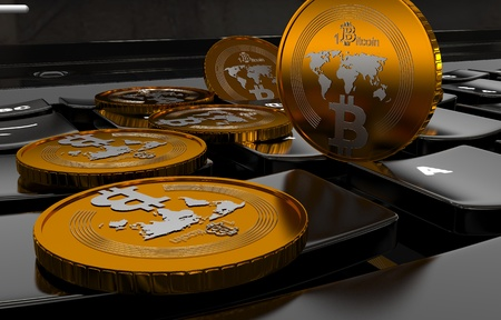 Bitcoin physical coin symbol on white keyboard
