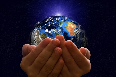 earth planet: Child holding a glowing earth globe in his hands. Earth image provided by Nasa. Stock Photo