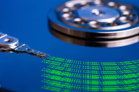 disks: Modern technologies background with binary code and hard disk