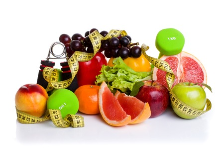 muscle fiber: fitness equipment and healthy food isolated on white. green and red apples, pepper, grapes, grapefruit, parsley, nectarines, dumbbells and measuring tape