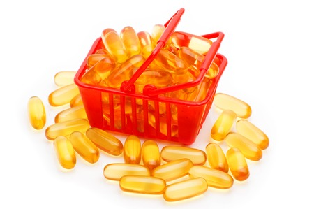 lecithin: Cod liver oil Omega 3 gel capsules in the shopping basket, isolated on white background