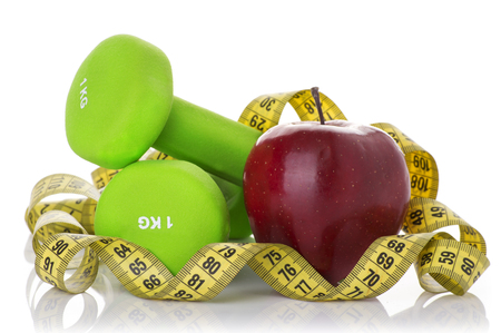 muscle fiber: Two dumbbells, red apple, measuring tape and a stopwatch isolated on white background. Diet concept.