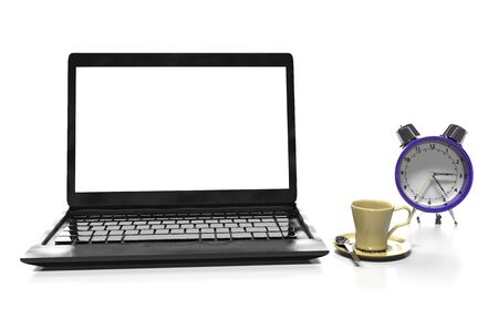 thea: alarm clock, laptop and cup of hot thea on table Stock Photo