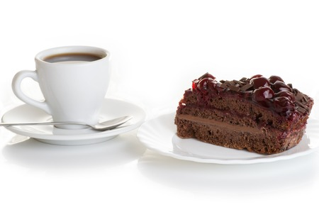 fruit plate: cup of coffee and piece of cake with cherries