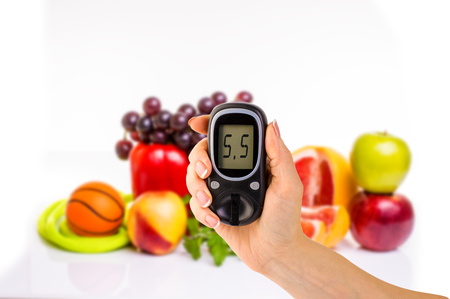 glucometer: glucometer for glucose level and healthy organic food on a white background.