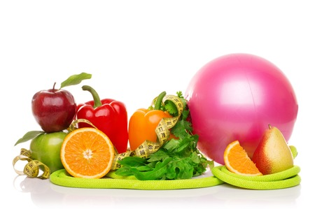 fitness equipment and healthy food isolated on white, green and red apples, pepper, grapes, grapefruit, parsley, nectarines, dumbbells and measuring tape