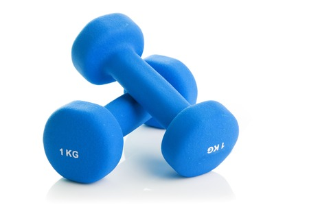 Two green dumbbells on a white background Stock Photo