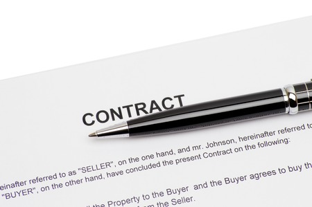 contract of house sale with money in background. Concept of closed deal.