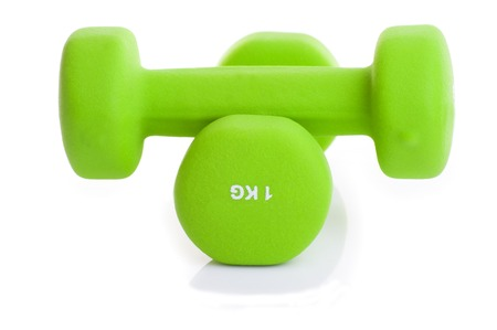 two green dumbbells isolated on white background Stock Photo