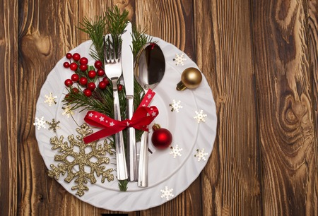 grunge cutlery: Christmas table place setting with christmas pine branches,ribbon and bow. Christmas holidays background Stock Photo