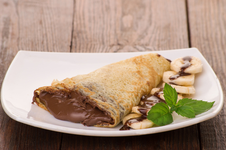 Crepes with chocolate cream and banana