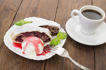 strudel: cherry strudel with ice cream and a cup of coffee
