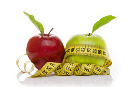 Green Apple and Red Apple with measuring tape on white background