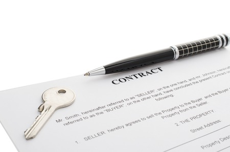 real estate sold: Keys of a new house on a signed contract of house sale with money in background. Concept of closed deal. Stock Photo