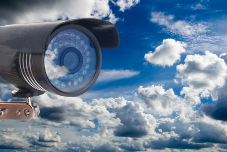 outdoor video camera on the background of a beautiful cloudy sky