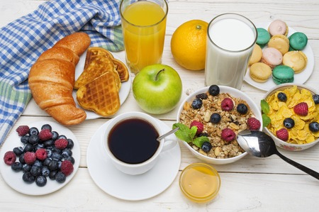 Breakfast served with coffee, orange juice, croissants, cereals and fruits. Balanced diet Stock Photo
