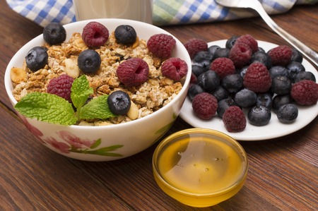 Breakfast served with orange juice, croissants, cereals and fruits. Balanced diet. Stock Photo