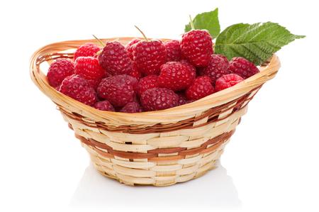 ripe raspberries in basket with mint on white Stock Photo