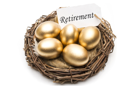 Nest with golden eggs with a tag and a word retirement on a white background. The concept of successful retirement. Stock fotó