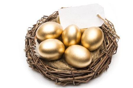 Nest with golden eggs with a tag and place for text on a white background. The concept of successful retirement. Stock fotó