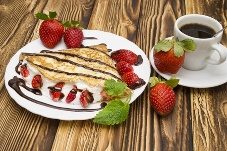 Crepes with Banana, Chocolate and strawberries with cup of coffee.