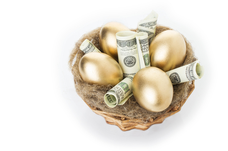 Nest with golden eggs on a white background. Golden Eggs in Nest with of Dollars