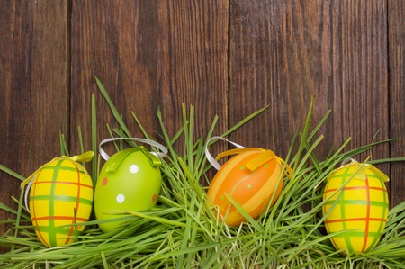 Easter decoration with eggs on a wooden background.