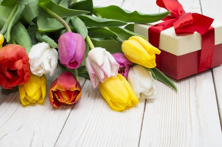 bouquet of tulips with a gift on rustic wooden board 스톡 콘텐츠 - 122215209