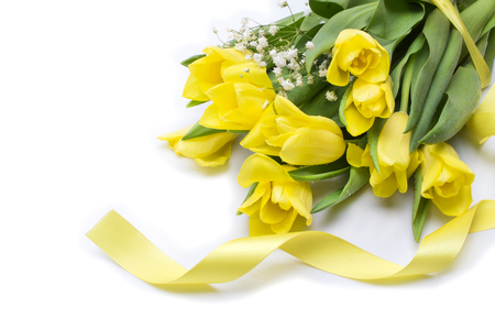 Yellow tulips with yellow ribbon on beige 스톡 콘텐츠 - 122215210
