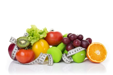 fitness equipment and healthy food isolated on white. apple, pepper, grapes, kiwi, orange, dumbbells and measuring tape. 스톡 콘텐츠