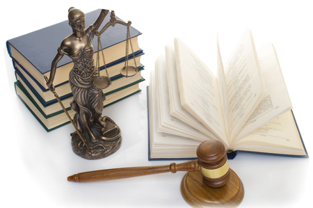 statue of justice on wooden table against the background of an open book. 스톡 콘텐츠 - 123433554