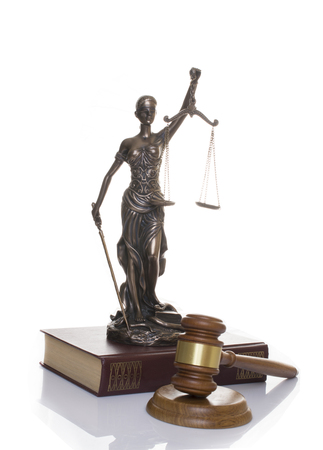 statue of justice, judges hammer behind books on a white background 스톡 콘텐츠 - 123433555