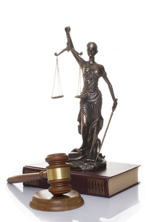 statue of justice, judges hammer behind books on a white background 스톡 콘텐츠 - 124601786