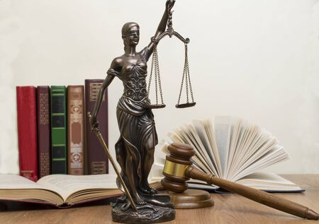 statue of justice on wooden table against the background of an open book. 스톡 콘텐츠 - 126175743