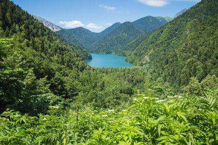 Panoramic view on mountain lake in front of mountain range 스톡 콘텐츠