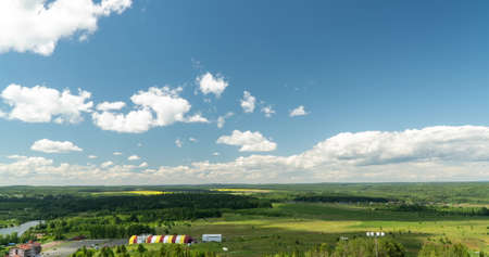 Beautiful cloudy landscape in summer time lapse. Blue sky with clouds 4K. Wonderful summer weather. The sun shines through the clouds. Clouds are floating in the sky Imagens