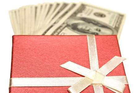 gift box and dollars on white. closeup photo