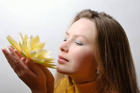 young woman with flower in hands Stock Photo - 6758798