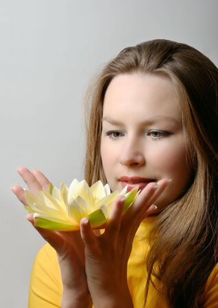 young woman with flower in hands Stock Photo - 6758800