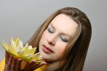 young woman with flower in hands Stock Photo - 6758803