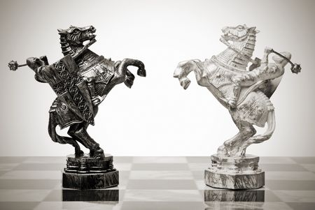 battle knights on horseback. chess pieces Stock Photo
