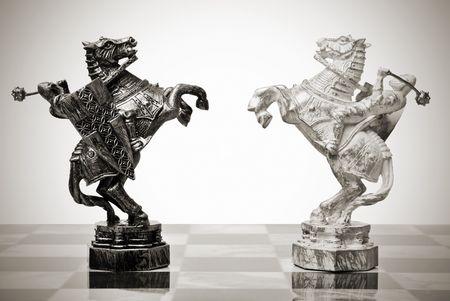 battle knights on horseback. chess pieces Фото со стока