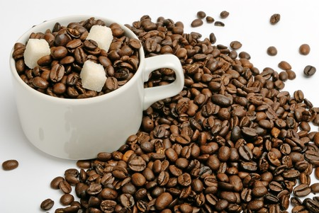 cup with coffee beans and sugar. closeup photo