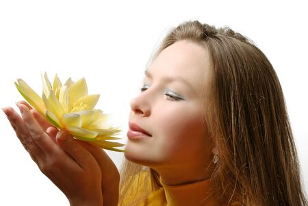attractive girl with flower in hands Stock Photo - 7363151