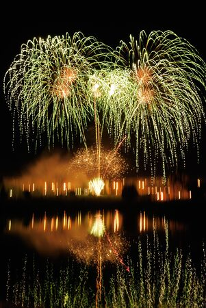 night traditional firework with reflection in water photo