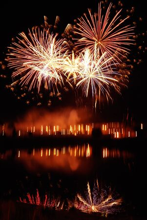 night traditional firework with reflection in water Stock Photo - 7483815
