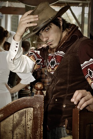 handsome man in cowboy clothes