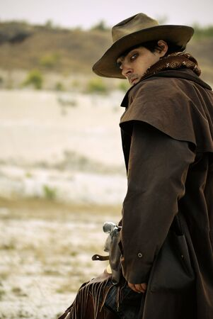 handsome man in cowboy clothes photo