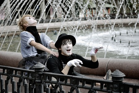 two mimes at fountain. pantomime photo